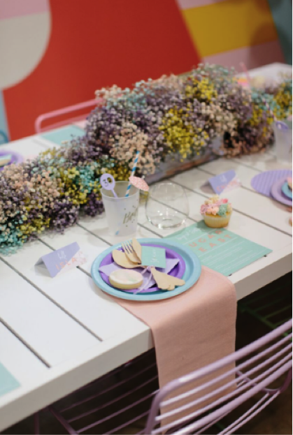 pastel plates, napkins, glassware