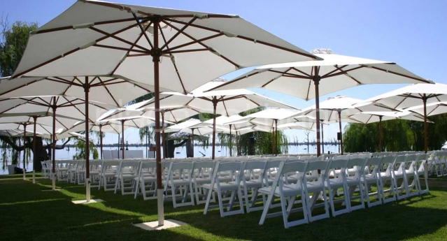 Features: White Padded Folding Chairs with Cream Market Umbrellas