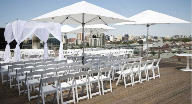Features: White Padded Folding Chair with White Market  Umbrellas