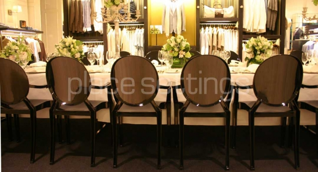 Features: Black Louis Ghost Chairs