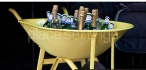 Yellow Wheelbarrow filled with Champagne